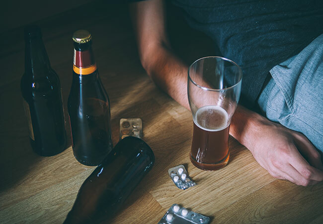 substance-category-bottles-and-pills-on-the-floor-around-person
