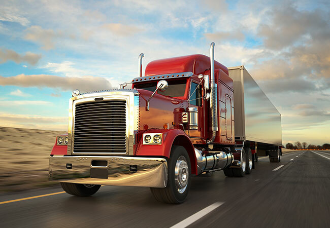 tdg-category-semi-truck-driving-down-road