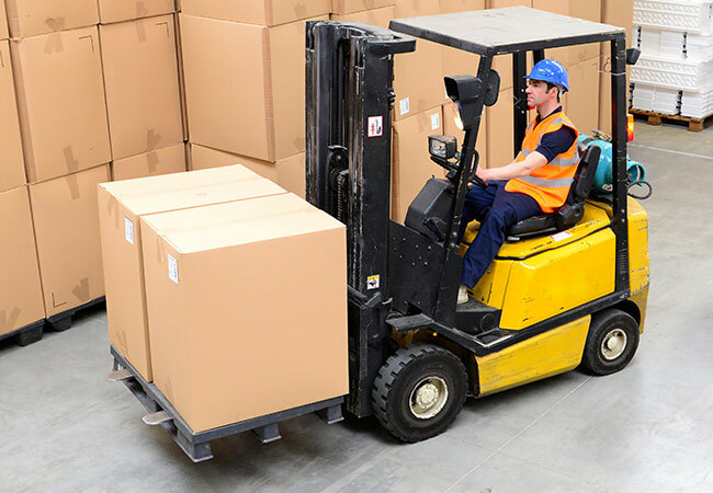 equipment-category-worker-driving-forklift-in-warehouse